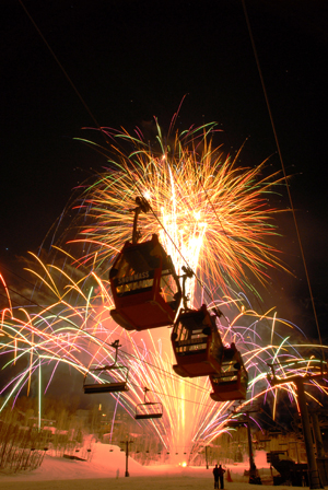Fireworks behind ski lifts